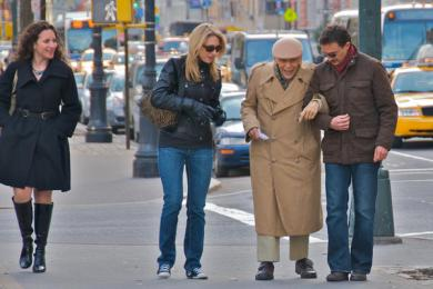Strangers helping an elderly man